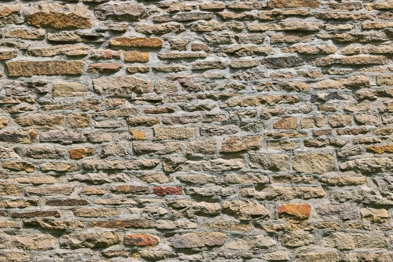 Texture du mur de pierre de maison historique photographie stock libre de droits