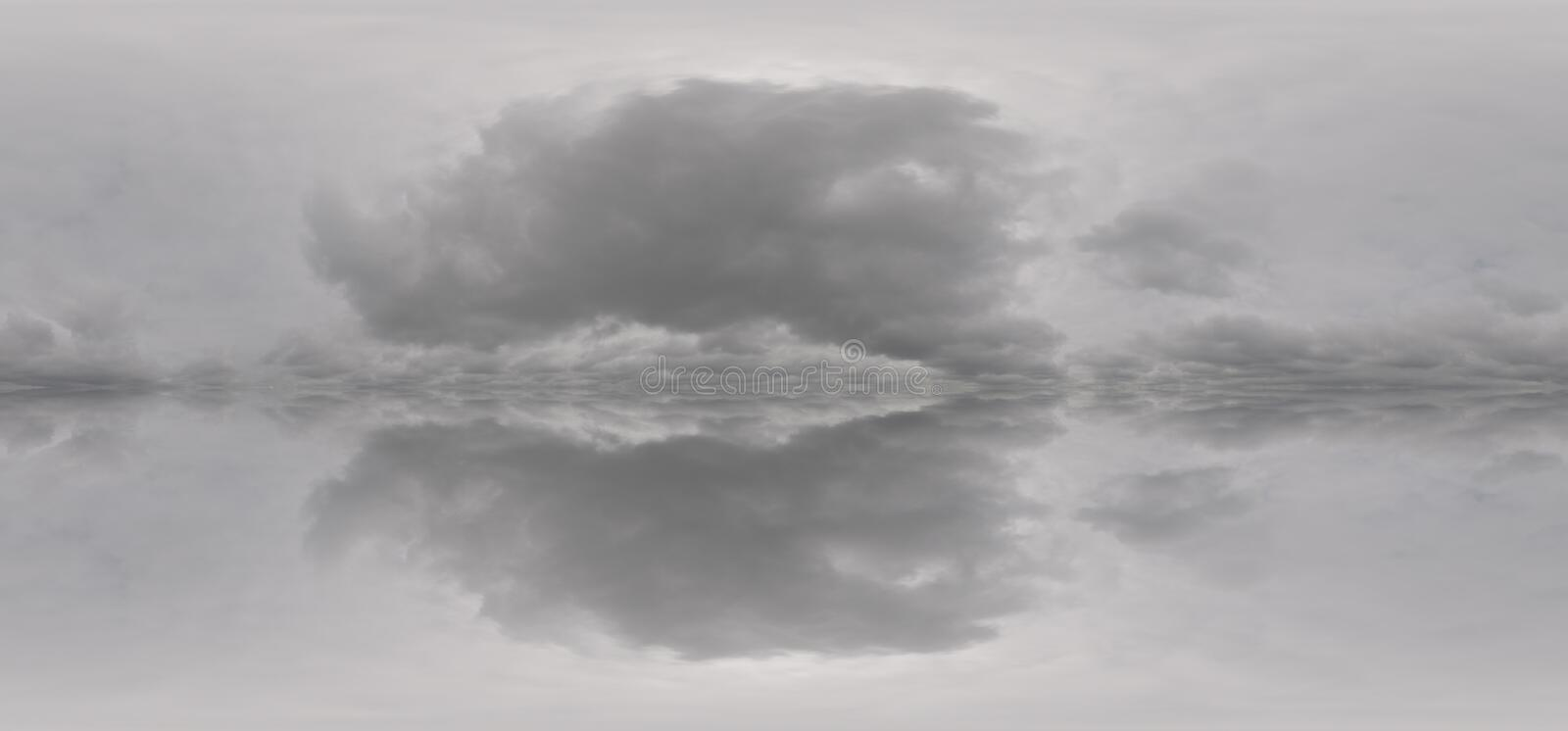 Texture duplication of black and white clouds. The texture is the reflection of gray clouds stock photo