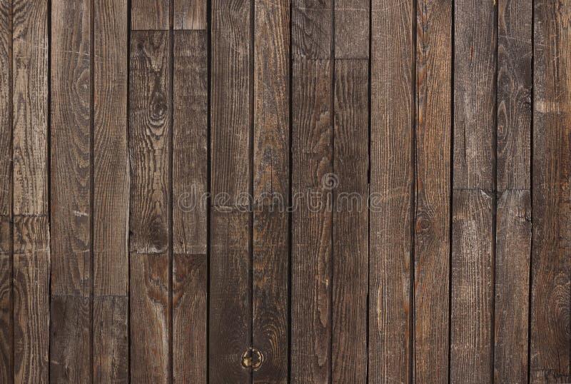 Texture en bois brune fonc?e avec le mod?le ray? naturel pour le fond image libre de droits
