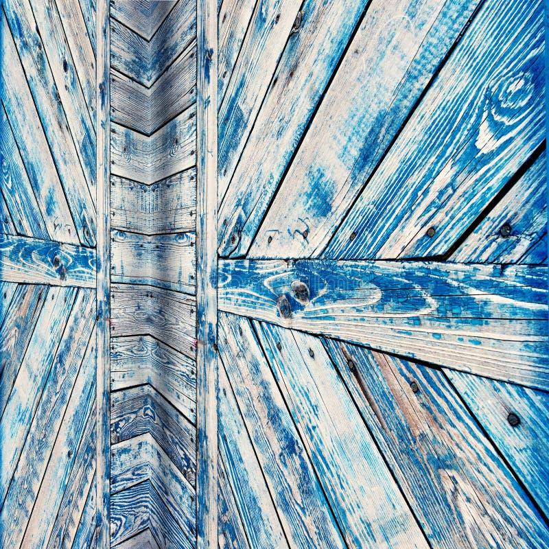 Texture en bois de porte superficielle par les agents par bleu photo stock