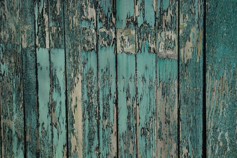 Texture en bois grise verte de vieux panneaux frangés de barrière photographie stock libre de droits