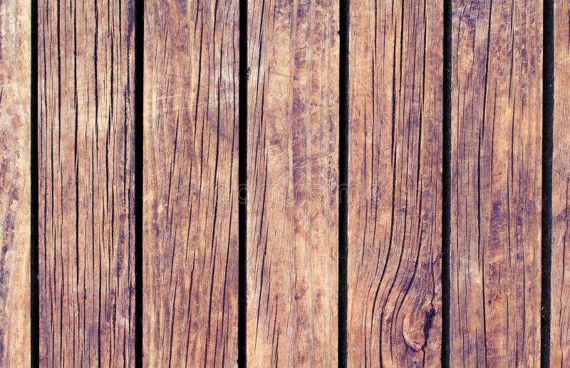 Texture en bois rustique avec les lignes verticales Fond en bois brun chaud pour la bannière naturelle photo libre de droits