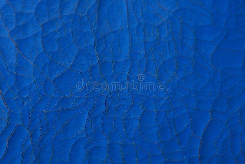 Texture en cuir bleue d'un morceau de remplissage avec des fissures photo libre de droits