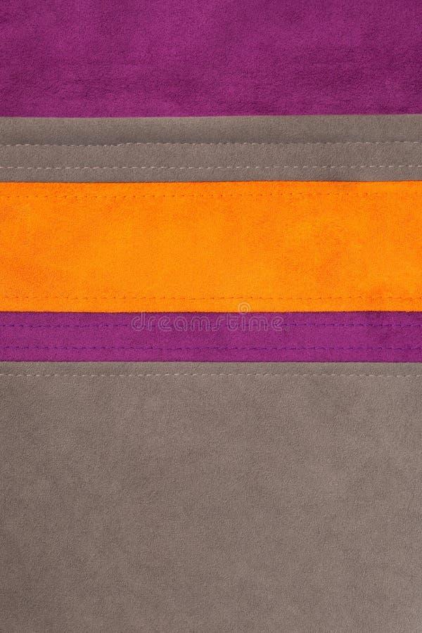 Texture en cuir orange, brune et pourprée cousue image libre de droits