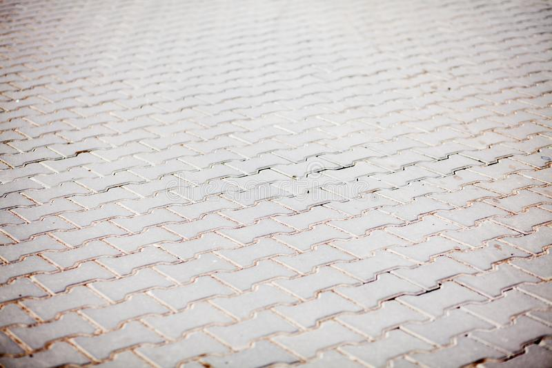 Texture en pierre de trottoir Fond cobblestoned de trottoir de granit Fond abstrait de vieux plan rapproché de trottoir de pavé r photo stock