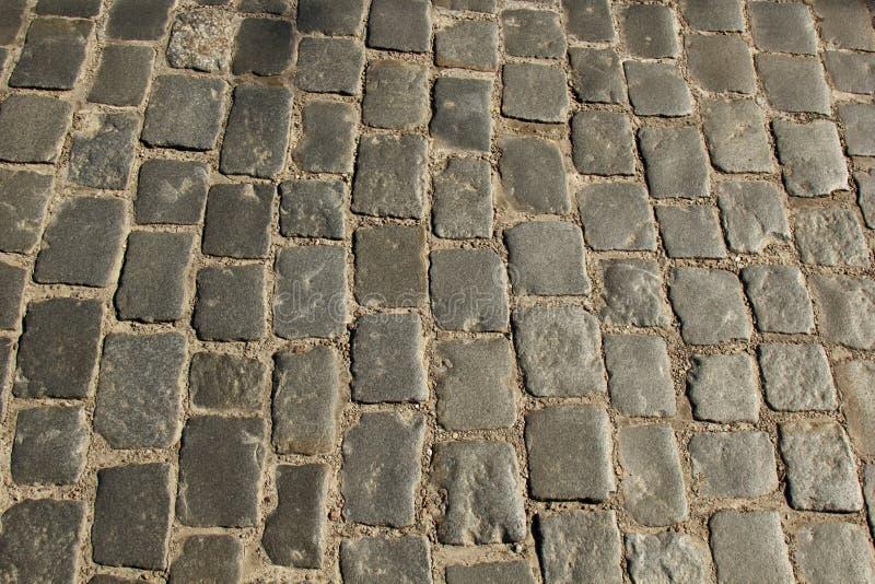 Texture en pierre de trottoir Fond cobblestoned de trottoir de granit Fond abstrait de vieux plan rapproch? de trottoir de pav? r photos libres de droits