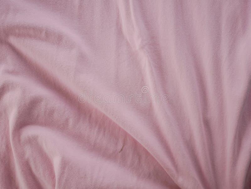 Texture en soie douce de satin de rose, fond coloré de tissu de coton photo libre de droits