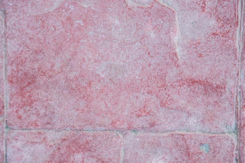 Texture erased corrupted Burgundy cement tiles.  royalty free stock image