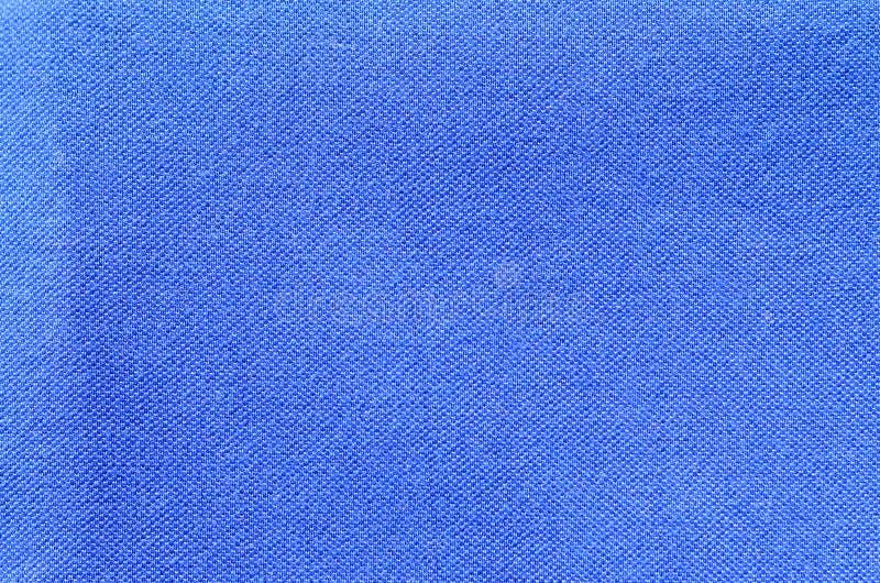 Texture et backgroun bleus d'habillement de chemise de débardeur de sport image libre de droits