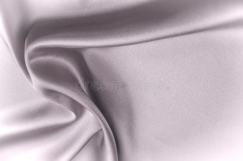 Silk. Texture fabric background. Black white silk fabric. Fragment of an abstract background of luxurious fabrics or liquid waves or wavy folds of a grunge silk stock illustration
