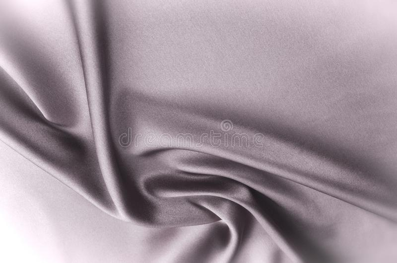 Texture fabric background. Black white silk fabric. Fragment of. An abstract background of luxurious fabrics or liquid waves or wavy folds of a grunge silk stock illustration