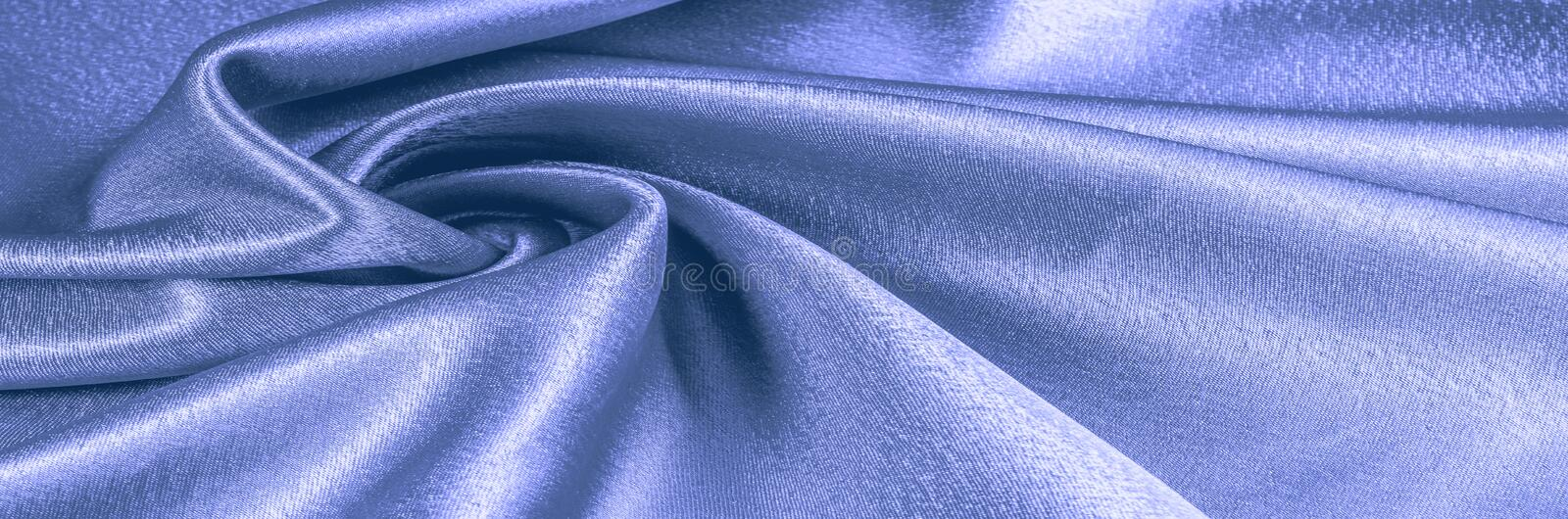 Texture, Fabric made of silk fabric, metal thread. metallic shee. N. blue. The blue ocean. Emerald green metallic. What a dazzling sight this turquoise and royalty free stock image