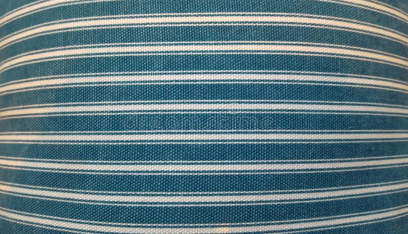 Texture of a fabric of a pillow, sofa, bed, background. Close up, striped, blue and white horizontal lines. royalty free stock image
