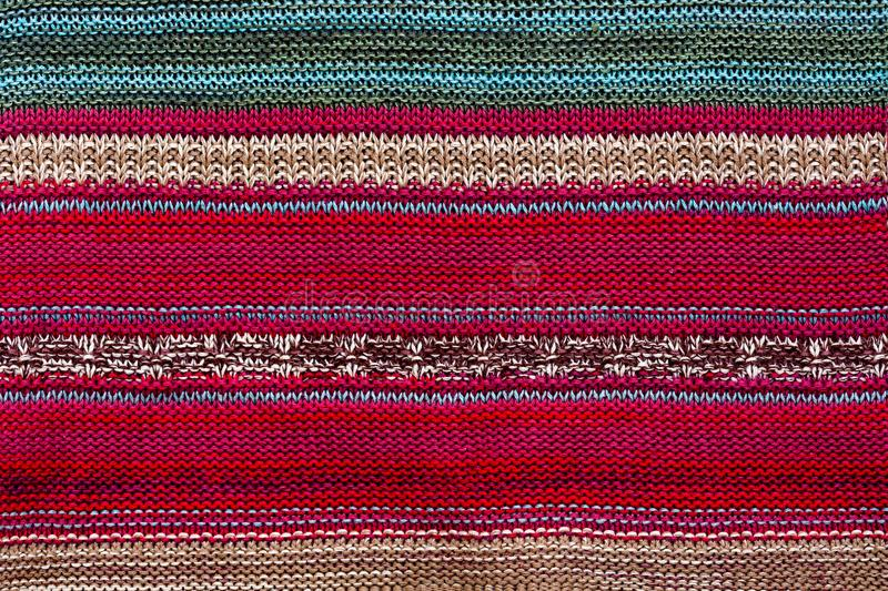 Texture fabric with striped bright pattern. Christmas. Scrapbooking. Knitted background. Rug, knitting, loops, royalty free stock image
