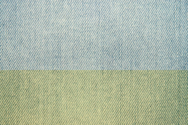 Texture of faded jeans fabric. Abstract pale texture of the faded fabric for jeans stock photo