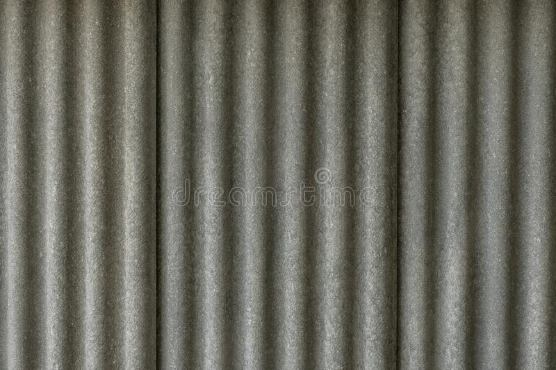 Texture of fiber cement roof sheet. Close up of corrugated wave asbestos tile. Classic style royalty free stock photos