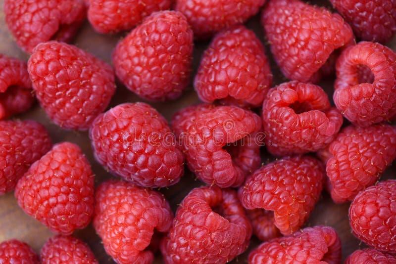 Texture/fin fraîches de framboise vers le haut de fond de fruit de framboises rouges photo libre de droits