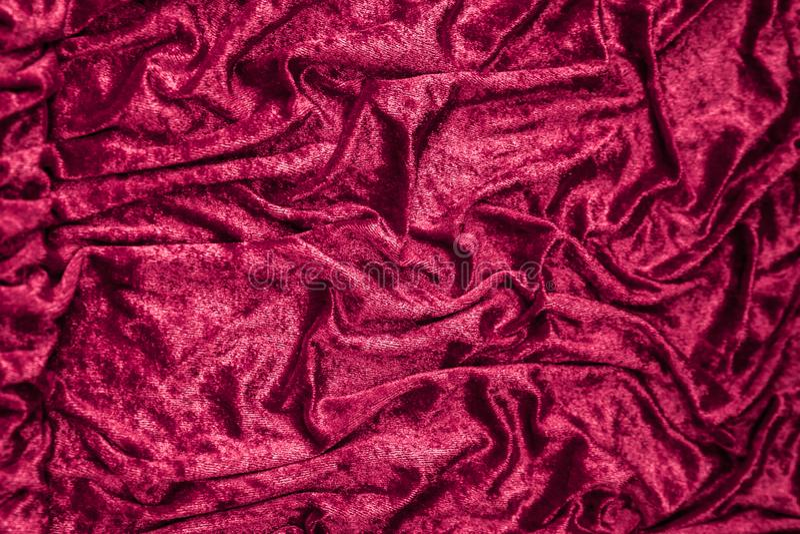 Texture, fond de tissu rose plié de satin photos stock