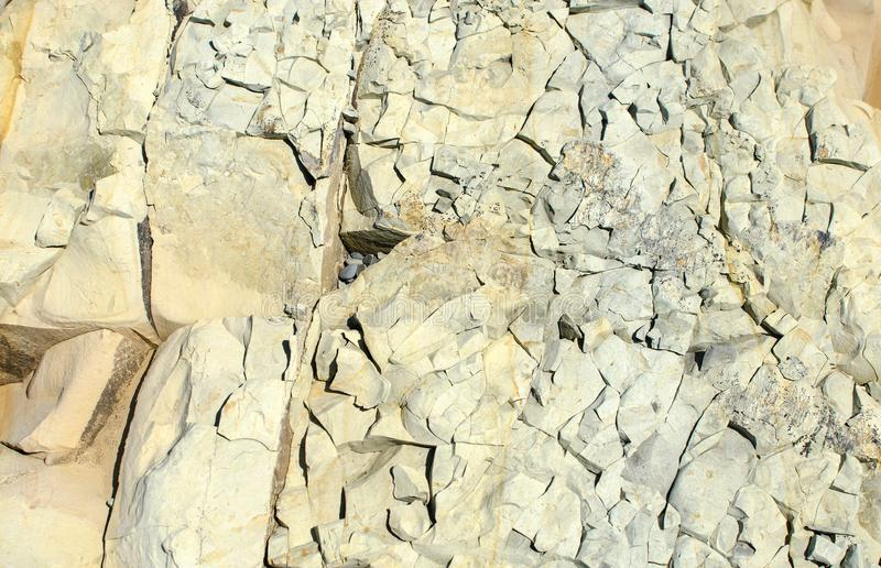 The texture of a fractured stone closeup royalty free stock image