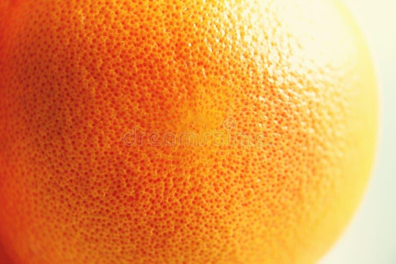 Texture of fresh bright orange peel, closeup, copy space. Macro of orange fruit. Citrus fruit background stock image
