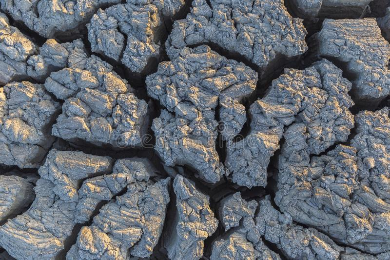 Texture of fresh mud spewing from mud volcano. Back royalty free stock images