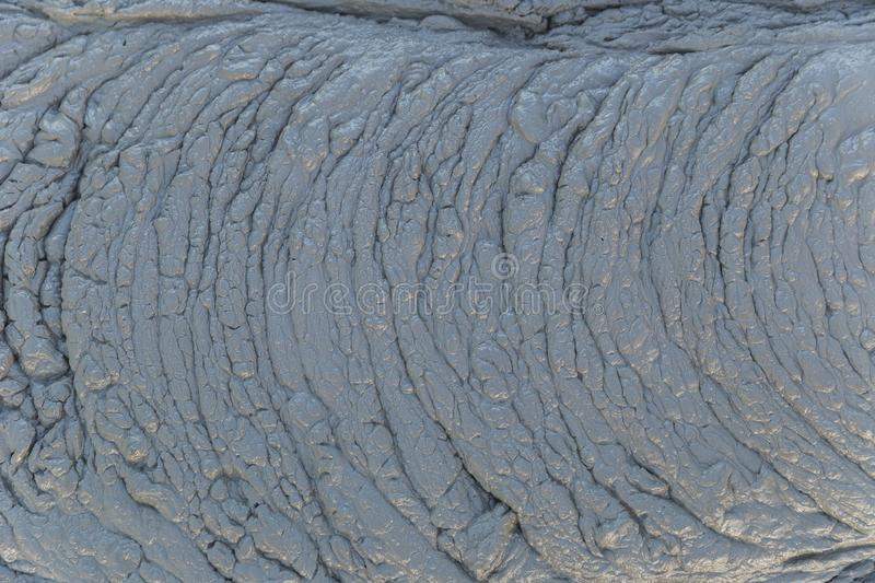 Texture of fresh mud spewing from mud volcano. Back royalty free stock photos