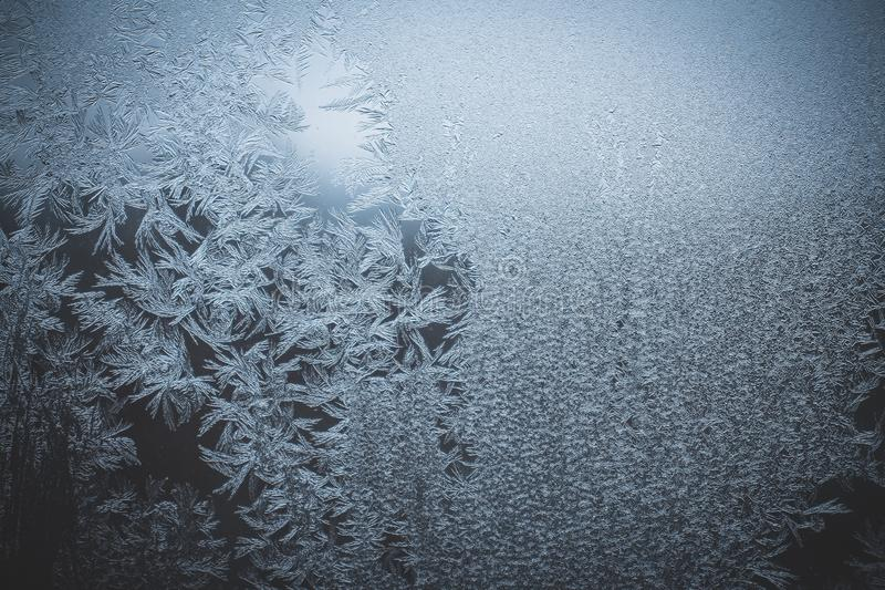 Texture of frost and ice on glass as a pattern and ornament of a winter cold stock photos