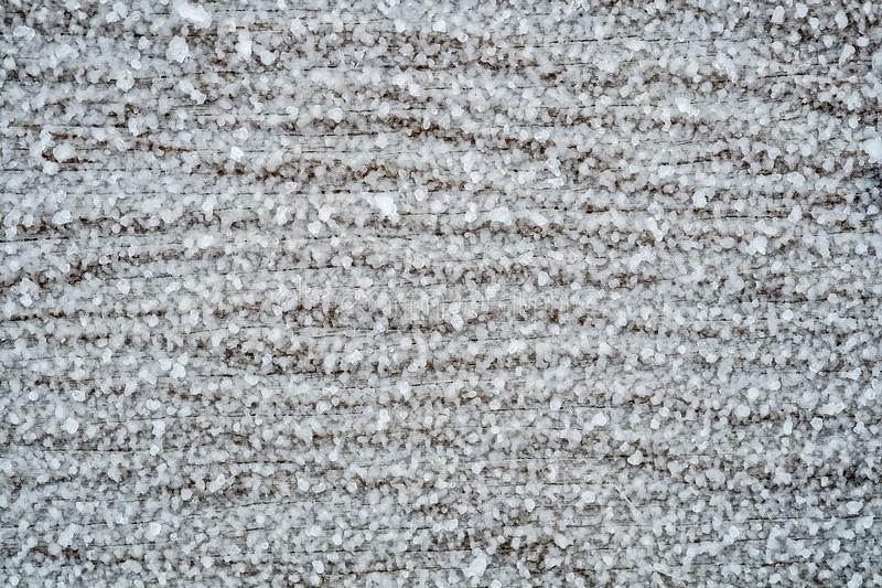 Texture frost on a piece of wood. Close up of frozen ice or sleet on a piece of wood on a stormy winter day stock photos