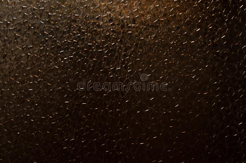 Corrugated glass pattern texture. The texture of the glass, a beautiful pattern on the glass. Stained glass stock photo