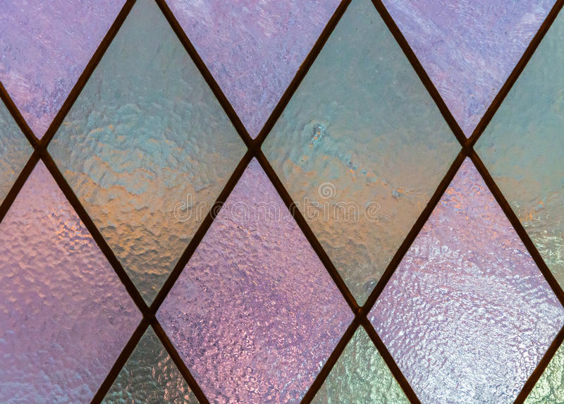 The texture of the glass in beautiful stained glass. Bright multicolor texture of the glass on the beautiful and brilliant stained glass royalty free stock images