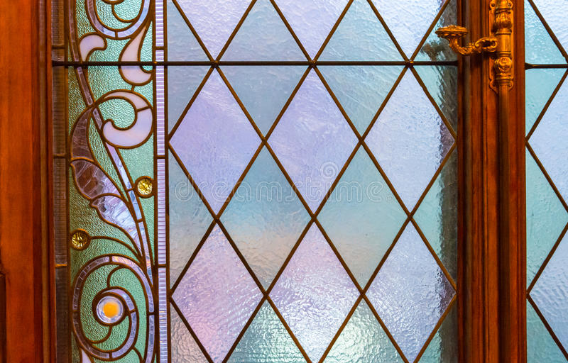 The texture of the glass in beautiful stained glass. Bright multicolor texture of the glass on the beautiful and brilliant stained glass royalty free stock photography