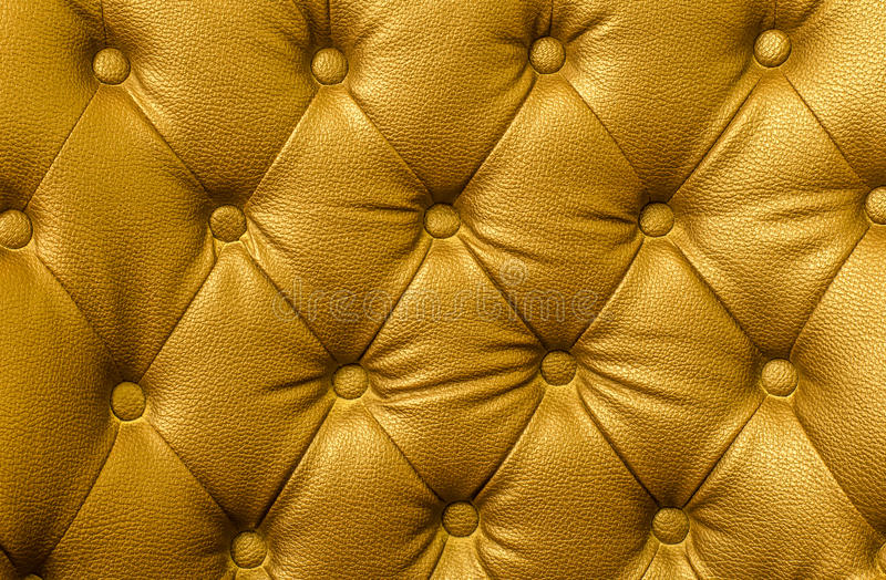 Texture of gold leather vintage sofa royalty free stock photography