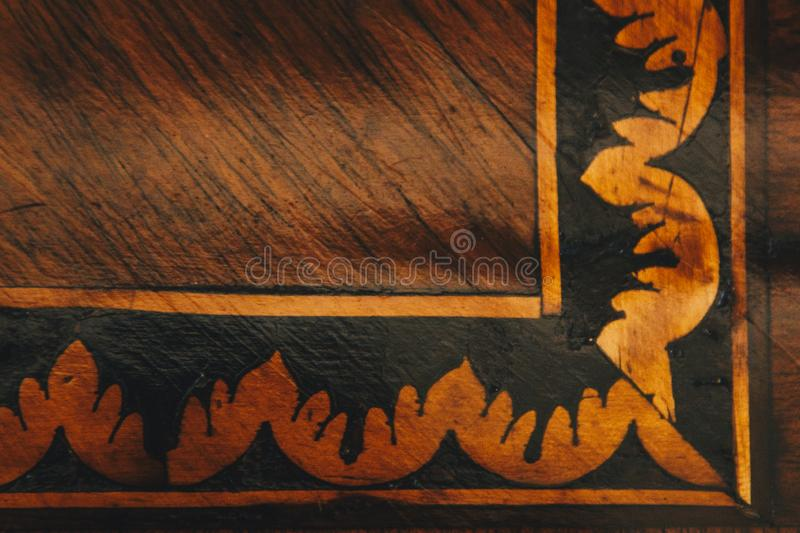 Texture of gold pattern on the old wooden panel close-up. structure of a scratched tree. background stock images