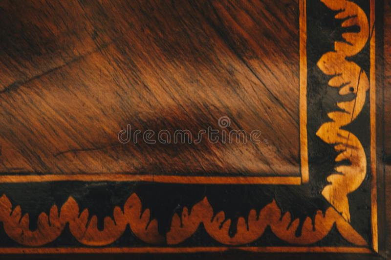 Texture of gold pattern on the old wooden panel close-up. structure of a scratched tree. background royalty free stock photography