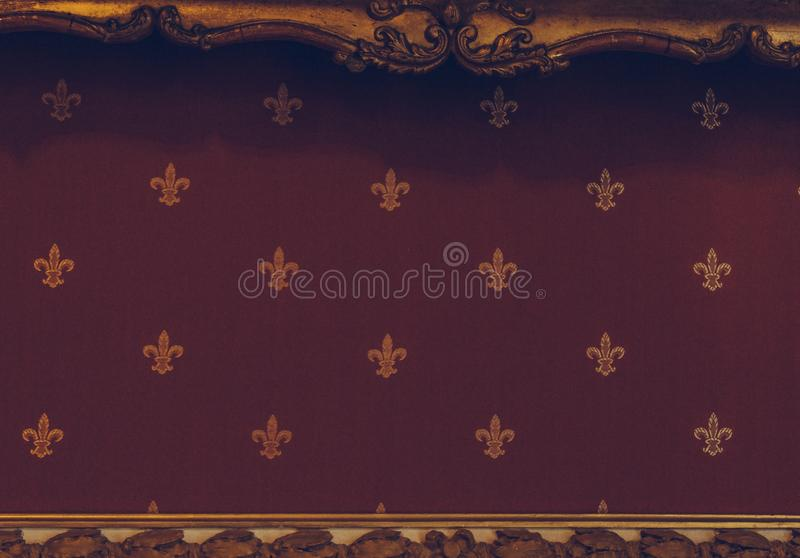 Texture of the golden crown pattern on a red velvet canvas. royal symbols closeup on luxury fabrics royalty free stock photos