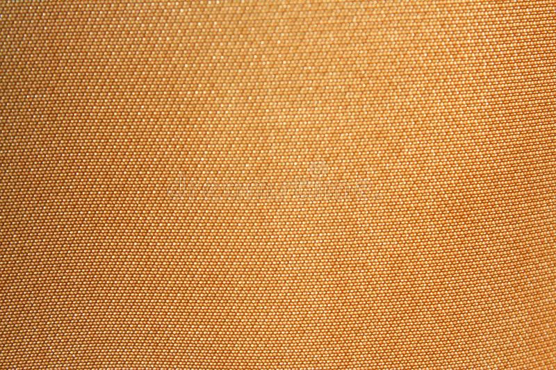 Texture golden fabric. Close up Texture golden fabric royalty free stock photos