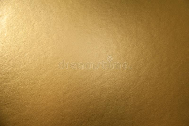 Texture of golden metallic background. Texture of golden metallic foil paper background for design Christmas or New Year`s or party cards royalty free stock images