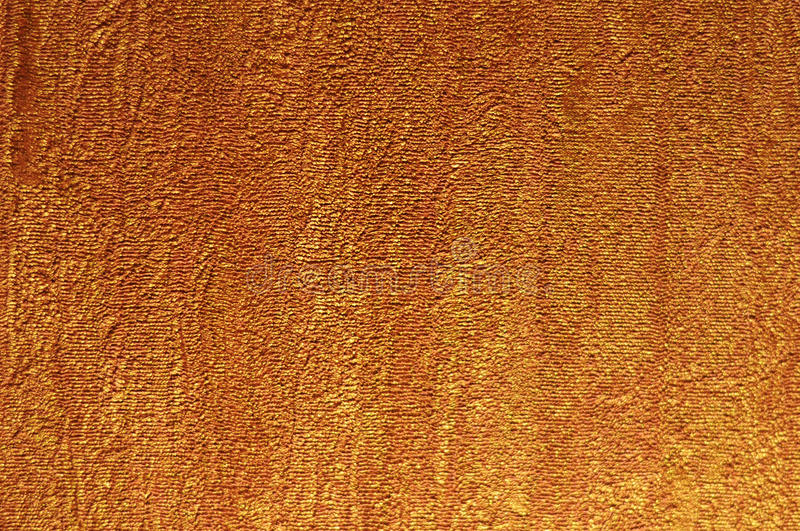Texture of golden wall. Details of the texture of a golden wall royalty free stock image