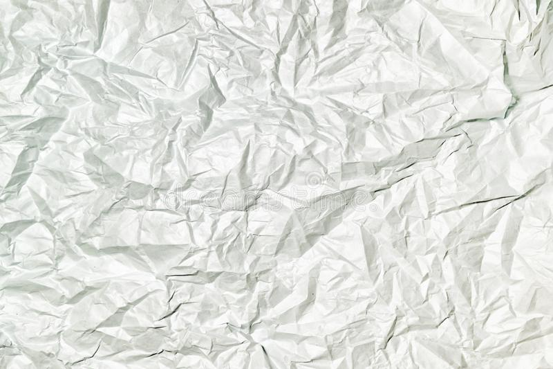 Texture of gray crumpled paper, abstract background for layouts. royalty free stock photo