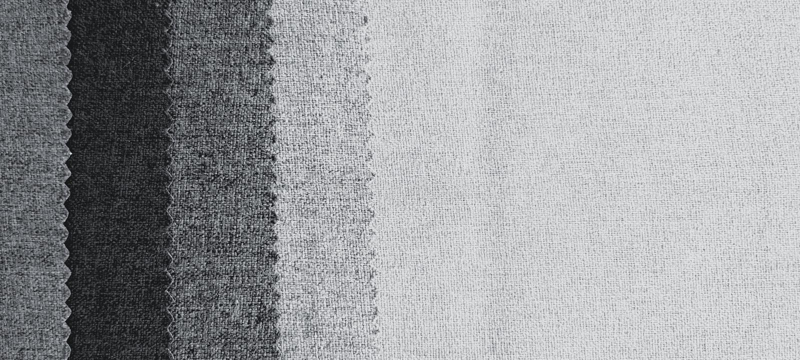 Texture of gray or grey fabric or cotton pattern for background with right copy space. royalty free stock image