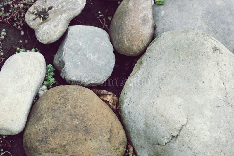 Texture of gray large sea stones. In natural environment, abstract, grunge, old stock photo