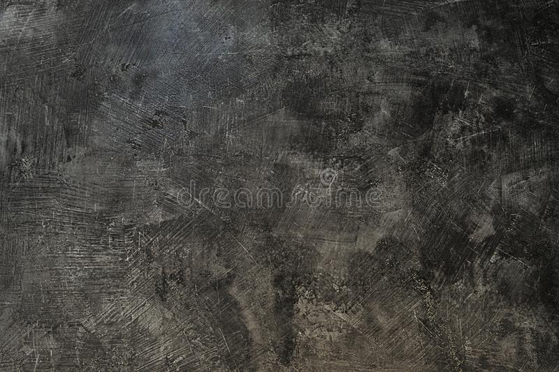 Texture of the gray polished concrete wall with scratches. Concrete wall royalty free stock photos
