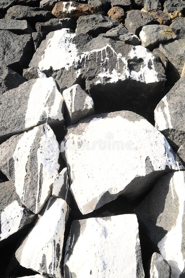 Gray Rock Ancient Wall. Texture Gray Rock Ancient Wall made of Volcanic Rocks and Dropping Paint stock illustration