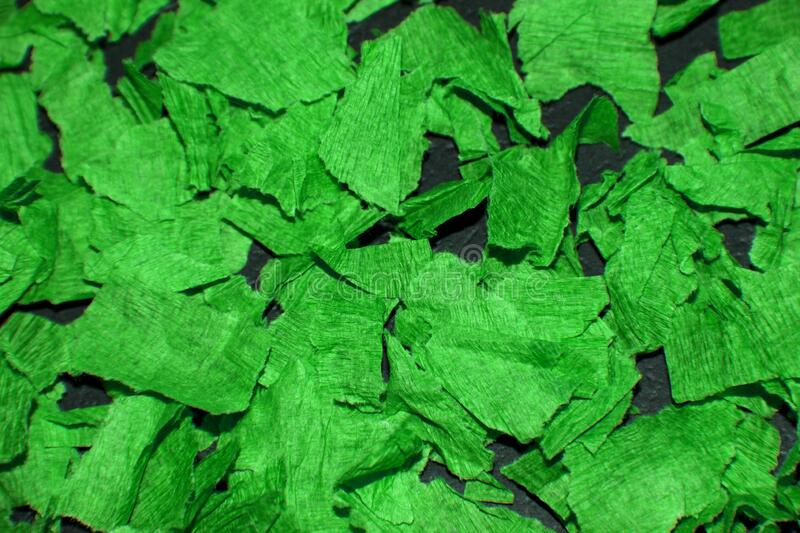 Texture of green torn paper. Abstract, bright background.  stock photos