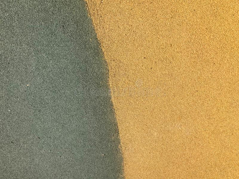 The texture is green and yellow from soft protective rubber, rubber crumb for safety used for playgrounds, workout. The background stock photos