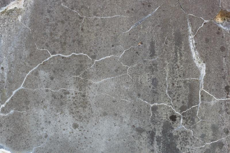Texture of grey granite plate with cracked surface. Background pattern. Texture of old grey granite plate with cracked surface. Background pattern stock photo