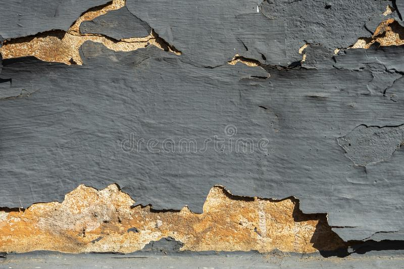Texture of grey old cracked stone or cement wall in sunlight for pattern, background or 3D. Horizontal, close up royalty free stock image