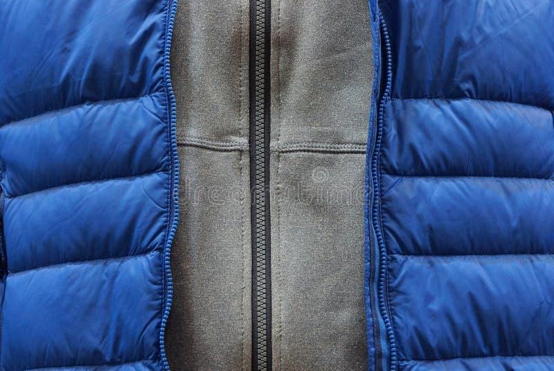 Texture grise bleue de tissu des vêtements et des vestes de fermeture éclair images libres de droits