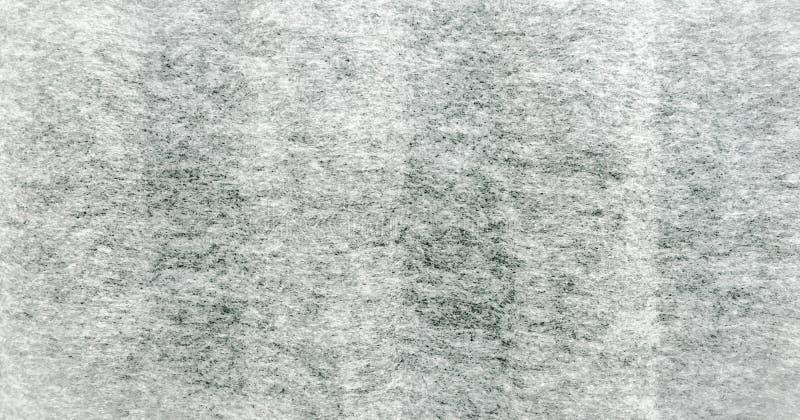 Texture grise de tissu de bruyère Le vrai gris de bruyère a tricoté le tissu fait en fond texturisé de fibres synthétiques photographie stock