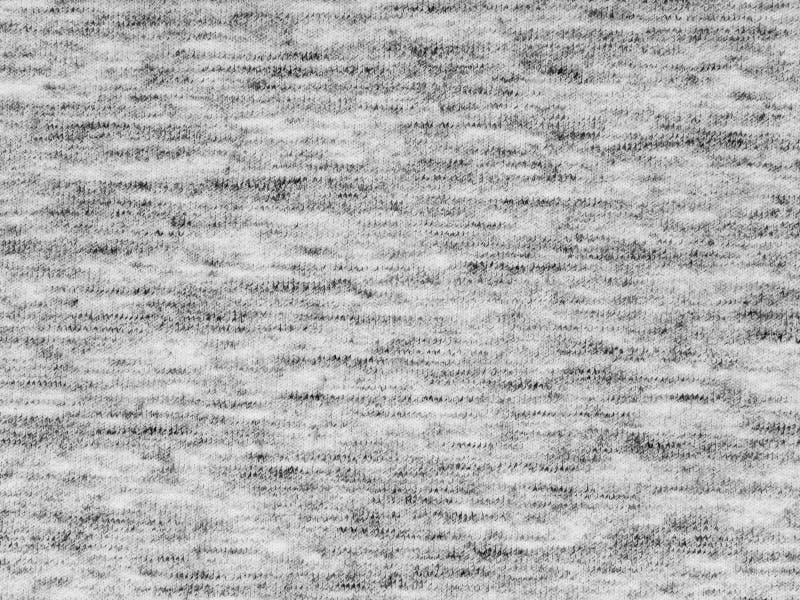 Texture grise de tissu de tricots de bruyère légère photos stock